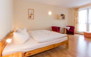 Ein Bett oder Betten in einem Zimmer der Unterkunft Pension Zum-Ratsherrn