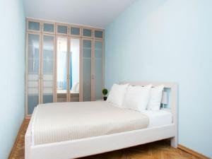 A bed or beds in a room at InnDays on Nagornaya