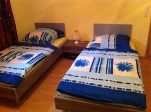 Ein Bett oder Betten in einem Zimmer der Unterkunft Appartements Funk