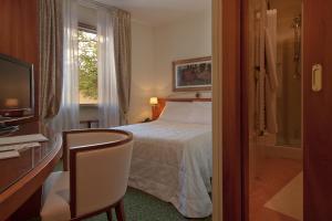 Letto o letti in una camera di Albergo Celide
