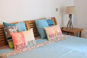 A bed or beds in a room at Bora Bora Enjoy