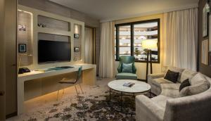 A television and/or entertainment center at Hilton Amsterdam Airport Schiphol