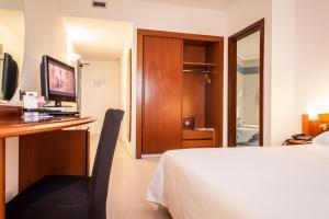Een bed of bedden in een kamer bij Hotel Donizetti