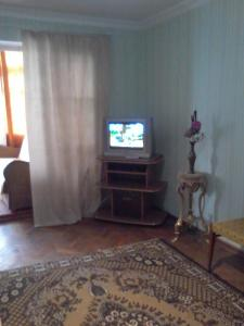 A television and/or entertainment center at Guest House Tengiz