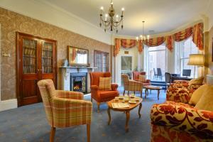 Ein Sitzbereich in der Unterkunft Best Western Kilima Hotel