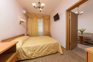 A bed or beds in a room at BFO Health Resort