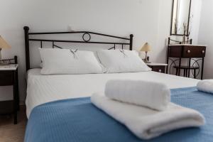 Un ou plusieurs lits dans un hébergement de l'établissement Astarti Apartments