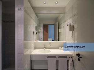 Ein Badezimmer in der Unterkunft Hotel Restaurant Florida