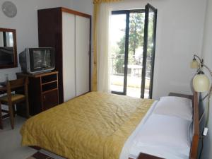 Кровать или кровати в номере Hotel Danica