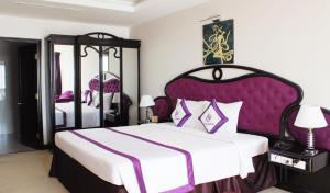 Un ou plusieurs lits dans un hébergement de l'établissement TTC Hotel - Can Tho