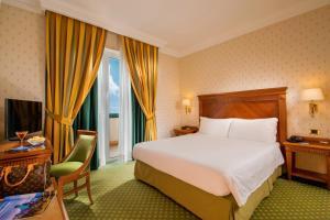 Letto o letti in una camera di Best Western Hotel Viterbo