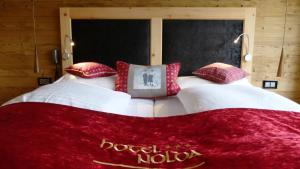 Ein Bett oder Betten in einem Zimmer der Unterkunft Hotel Nolda