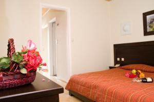 Ένα ή περισσότερα κρεβάτια σε δωμάτιο στο Paradise Apartments