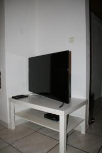 A television and/or entertainment center at Apartment Au Calme