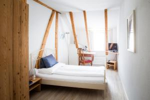 A bed or beds in a room at Classic Rooms by Carlton-Europe Vintage Adults Hotel