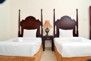 A bed or beds in a room at Sara Hotel Apartments - BAITHANS GROUP