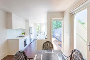 A kitchen or kitchenette at Boutique Stays - South Yarra Lane
