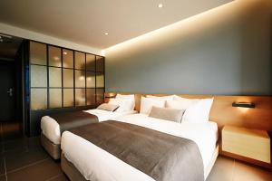 A bed or beds in a room at Staz Hotel Dongtan