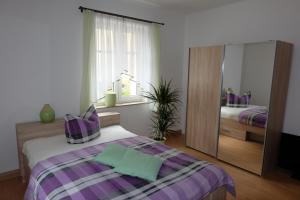 A bed or beds in a room at Im Kuckucksnest