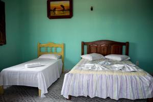 Cama ou camas em um quarto em Belas Praias Pousada