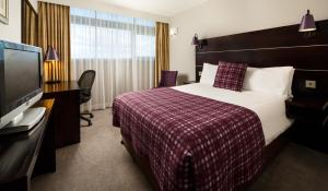 A bed or beds in a room at Mercure Manchester Piccadilly Hotel