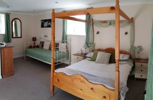 A bed or beds in a room at Staden Grange