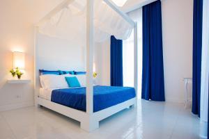 Letto o letti in una camera di Palazzo Murrano