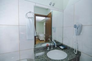 A bathroom at Pousada Iguassu Charm Suites