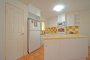 A kitchen or kitchenette at at Beach Court Holiday Villas