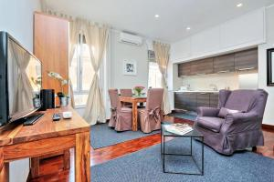 Coin salon dans l'établissement Residenza dell'Olmata - My Extra Home