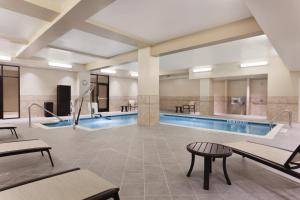 The swimming pool at or near Hilton Garden Inn Rochester Downtown