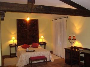 Cama o camas de una habitación en Hotel Posada Molino del Cubo