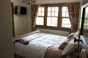 Säng eller sängar i ett rum på Buttercup Hill