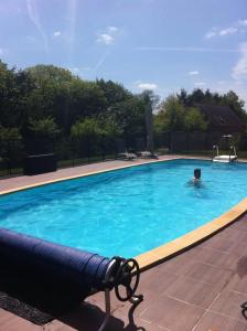 The swimming pool at or near Gîte du Roi Morvan