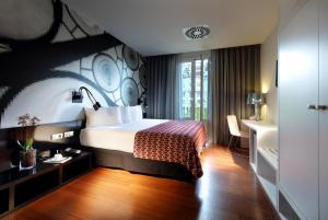 A bed or beds in a room at Eurostars Bcn Design