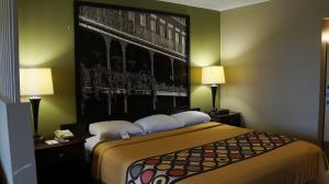 A bed or beds in a room at Super 8 by Wyndham New Iberia