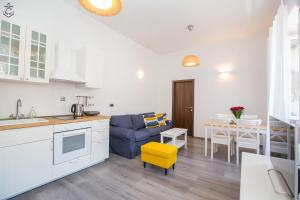 A kitchen or kitchenette at Central Apartment