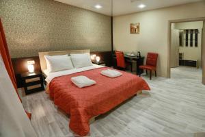 Кровать или кровати в номере Отель Элизиум на Пушкинской