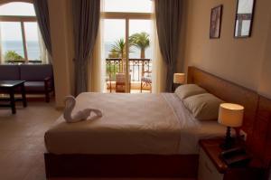 A bed or beds in a room at Elaria Hotel Hurgada