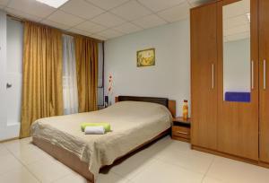 A bed or beds in a room at Brusnika Hotel Nagornaya