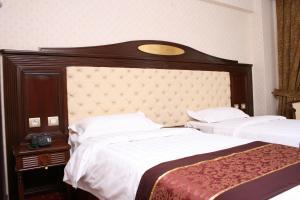 Кровать или кровати в номере Hestia Hotel