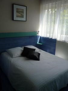 Un ou plusieurs lits dans un hébergement de l'établissement Hotel de la Plage