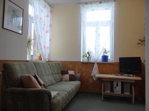 Ein Sitzbereich in der Unterkunft Ferienwohnung Skiloipe