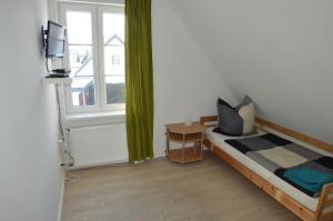 Ein Bett oder Betten in einem Zimmer der Unterkunft Borstel - Alte Schmiede