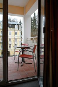 Balkón nebo terasa v ubytování Pension-Apartmany Cesky Dvur