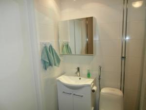 Kylpyhuone majoituspaikassa Apartment Nallisuites