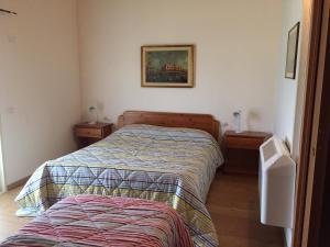 Letto o letti in una camera di Affittacamere Dormire Caldi