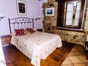 Cama o camas de una habitación en Posada Corral Mayor