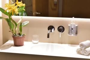 Ванная комната в Dazzler by Wyndham Asuncion