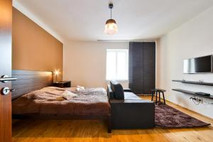 A bed or beds in a room at VITOM Apartments Ostrava
